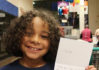 Child with Thank You Note